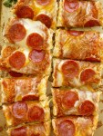 French Bread Pizza is perfectly crispy on the outside. No soggy pizza here! Topped with a jar of pizza sauce with added seasonings, pepperoni, and lots of cheese. It's a 30 minute dinner that's perfect for a busy weeknight meal.
