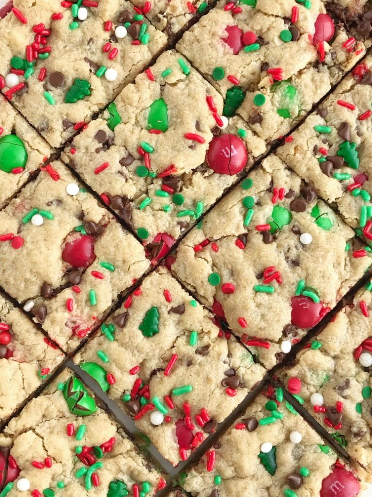 Santa's Cookies   Peanut Butter Oatmeal Cookie Bars   Christmas Recipe   Santa's cookie bars are perfect for Christmas Eve on the cookie plate! A soft, thick, and chewy peanut butter cookie bar loaded with oats, chocolate, peanut butter m&m's, and festive red and green sprinkles. #christmasrecipe #peanutbutterrecipes #dessert #dessertrecipe #recipeoftheday #holidayrecipe