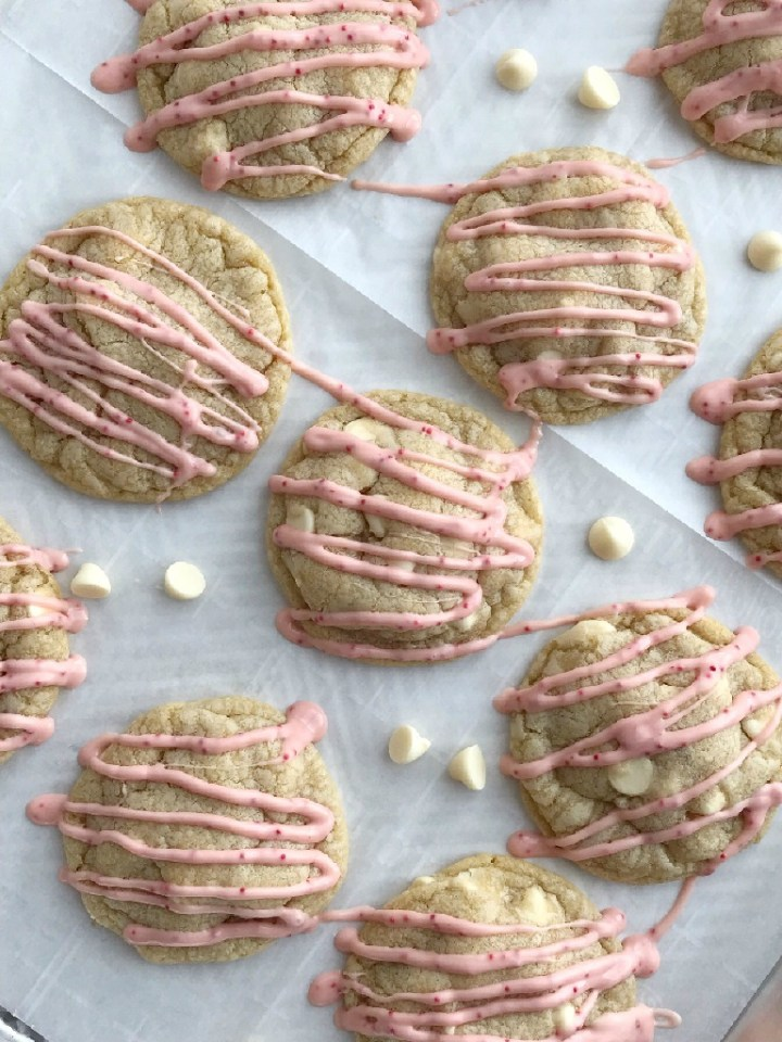 Soft baked white chocolate pudding peppermint cookies that are stuffed with a Hershey's candy cane kiss! These are the best Christmas cookies you'll ever have. Sweet, soft, thick, stuffed with a candy cane kiss, and drizzled with melted candy cane kisses.