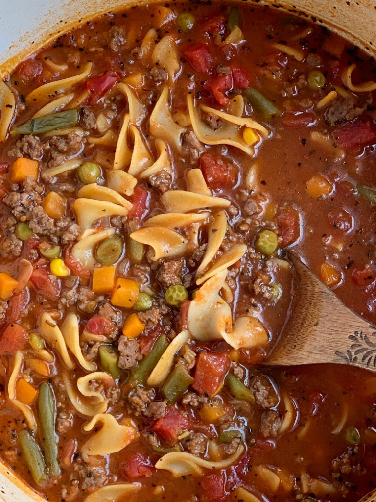 Vegetable Beef Noodle Soup | Vegetable Beef Soup | Vegetable beef soup is so easy to make with convenient ingredients! Ground beef, stewed tomato beef broth base, and vegetables with egg noodles. Cooks in one pot on the stove and is ready in 30 minutes. #soup #onepot #groundbeefrecipe #dinnerrecipe #easyrecipe #souprecipes