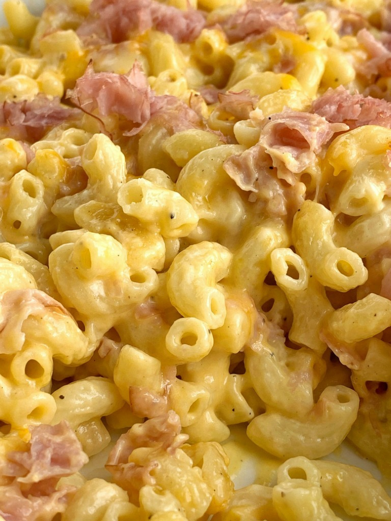 Macaroni and Cheese Ham Casserole is a family favorite dinner recipe! Pasta, cheese, cheddar cheese soup, and ham bake in one dish.