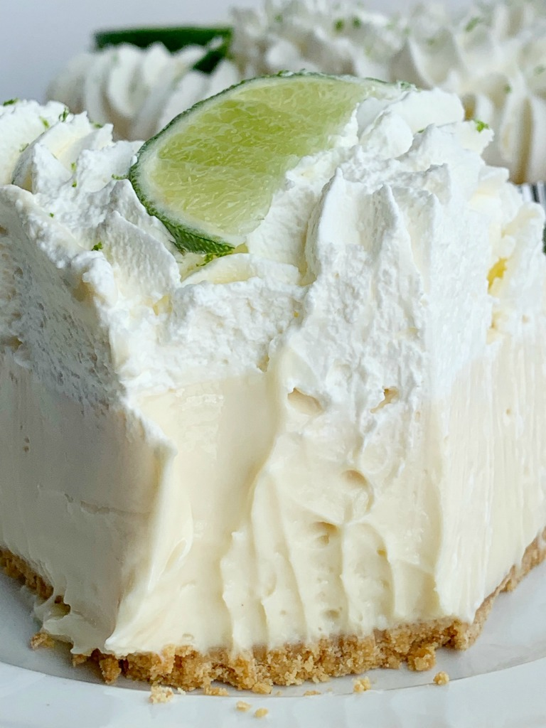 No Bake Key Lime Pie | Key Lime Pie | No Bake Desserts | Quick & easy Key Lime Pie is so easy to make and no baking required! A creamy, smooth, and sweet key lime cheesecake filling inside a prepared graham cracker crust. Garnish with key lime whipped cream for the best no bake dessert. #recipeoftheday #nobake #nobakedesserts #easydesserts #dessertideas #easterrecipes #keylimepie