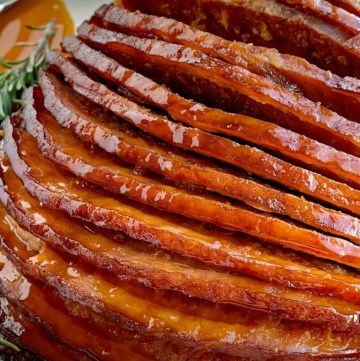 Slow Cooker Honey Glazed Ham   Ham Recipe   Boneless Ham   Crock Pot Ham Recipe   Honey glazed ham made in the slow cooker! Boneless, spiral sliced ham cooks in an easy 4 ingredients honey glaze. So flavorful and even easier to make this ham recipe. #ham #hamrecipe #easterrecipes #slowcooker #crockpotrecipes #honeyham