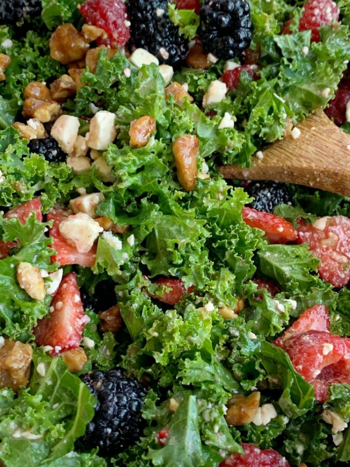 Citrus Berry Kale Salad   Kale Salad   Healthy Salad Recipe   Kale Salad with fresh strawberries, raspberries, and blackberries! Topped with feta cheese, glazed walnuts and a super simple homemade citrus olive oil dressing. This salad can make anyone a kale fan. #kalesalad #kalerecipes #healthyrecipes #salad #sidedish #saladrecipes #recipeoftheday #summerrecipes
