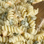 Close up shot of dill pickle pasta salad with creamy homemade dill dressing