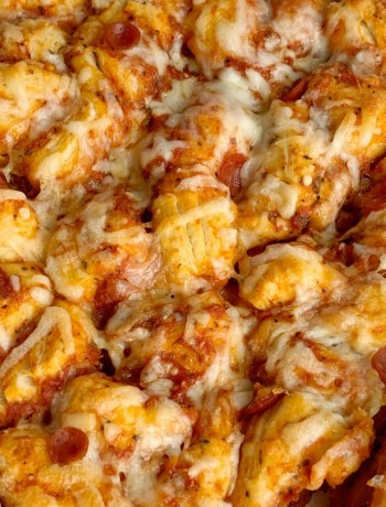 Pepperoni Pizza Biscuit Casserole   Pizza Casserole   Dinner   Pizza Casserole made with fluffy biscuits, pizza sauce, mini pepperoni, seasonings, and cheese! So easy to make and ready for dinner in just 30 minutes. #easyrecipes #dinner #dinnerrecipes #recipeoftheday #casseroles #pepperonipizza