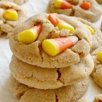 Candy Corn Peanut Butter Cookies | Candy Corn Cookies are a fun and delicious Halloween recipe. Soft-baked sweet peanut butter cookies with candy corn on top! Kids love to help push the candy corn on top the cookies!
