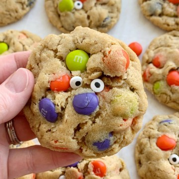 Halloween Recipe | Monster Cookies | Halloween Monster Cookies are chewy, soft-baked, and loaded with peanut butter, oats, Halloween m&m candies, and spooky candy eyeballs. These Halloween cookies are a fun and delicious way to celebrate Halloween!