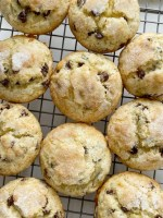 Chocolate Chip Banana Muffins bake up perfectly tall and round, soft-baked banana muffins, with chocolate chips and a sprinkle of sugar on top. You will love how soft and beautiful these banana muffins are!