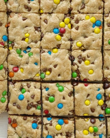 Chocolate Chip Cookie Bars are thick, chewy, soft-baked and absolutely perfect and bake up in one pan. Load them up with anything you want; chocolate chips, m&m's, chopped candy bar pieces, and even some pecans.