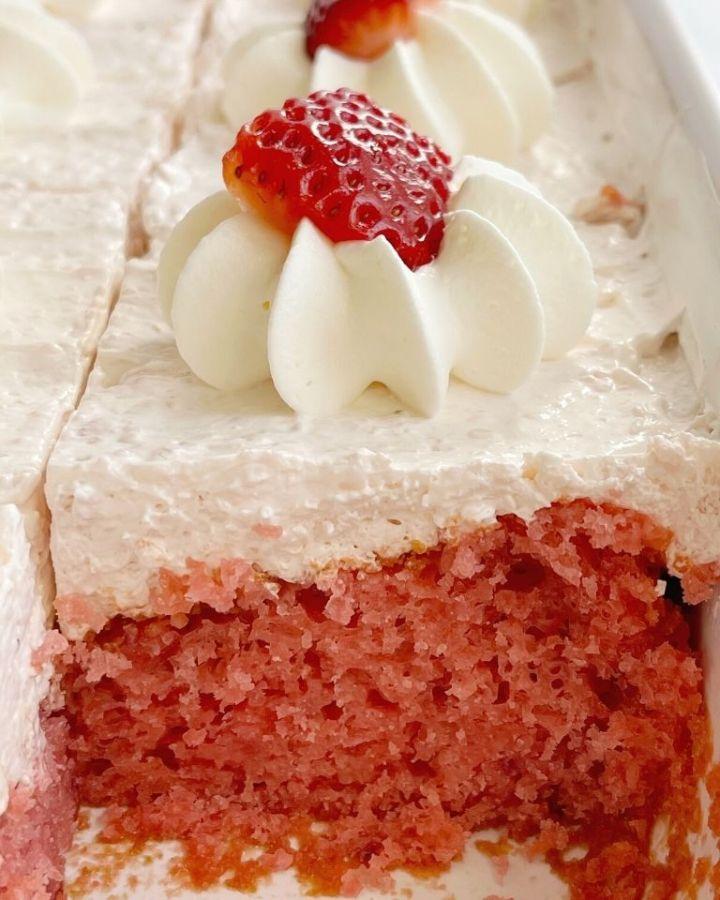Easy strawberry cake recipe inside a cake pan. This cake recipe uses a cake mix and jello mix.