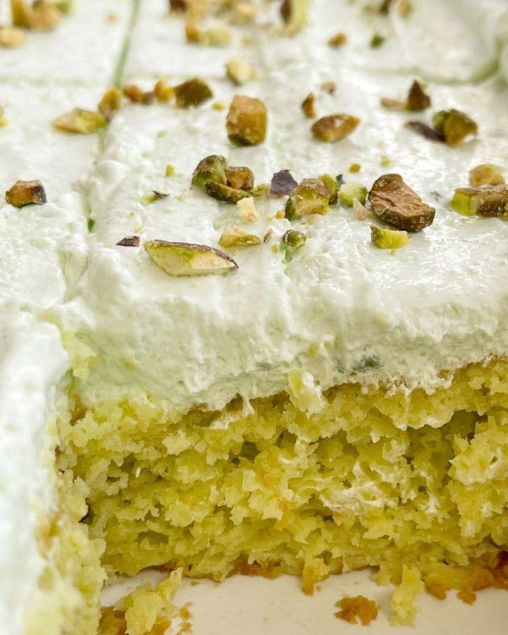 Pistachio cake inside a white cake pan.