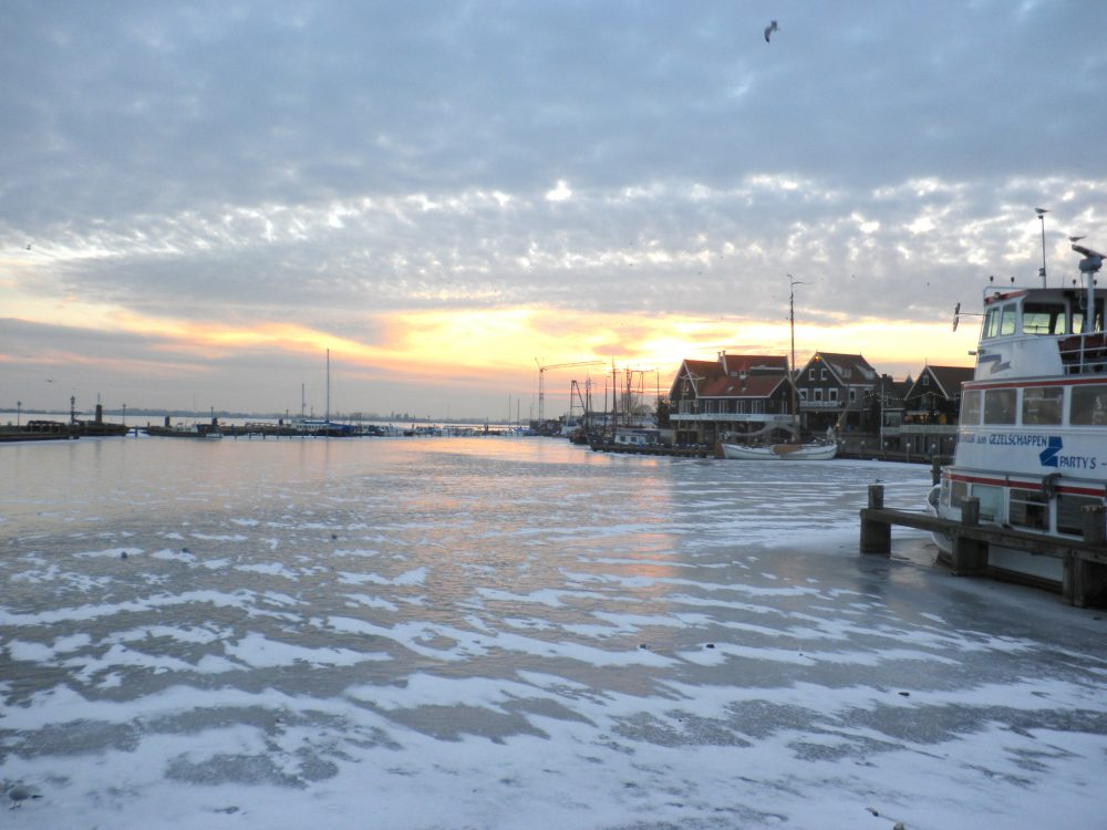 Weekend getaway ideas in the Netherlands - Volendam at sunset is gorgeous in the old harbour.