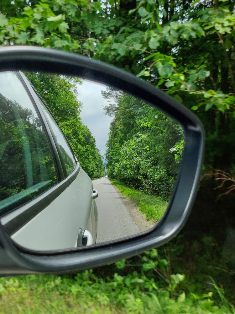 Road trip in Poland, view from the mirror