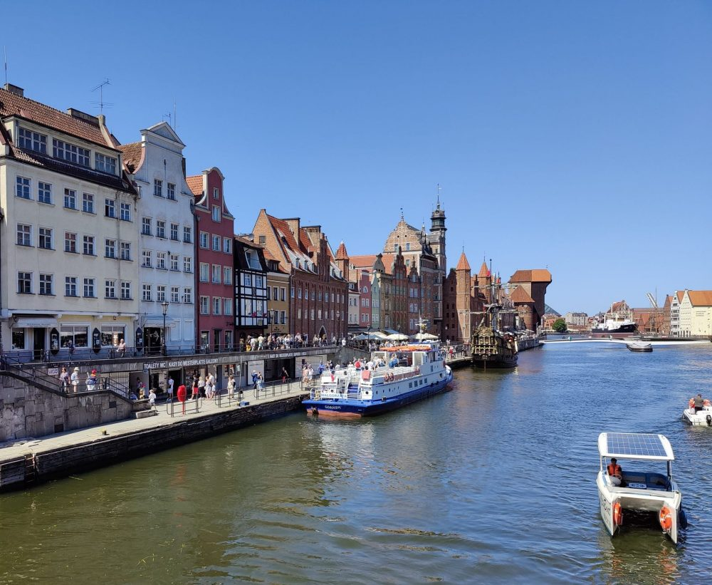 Gdansk in Poland with the houses and two boats on the river