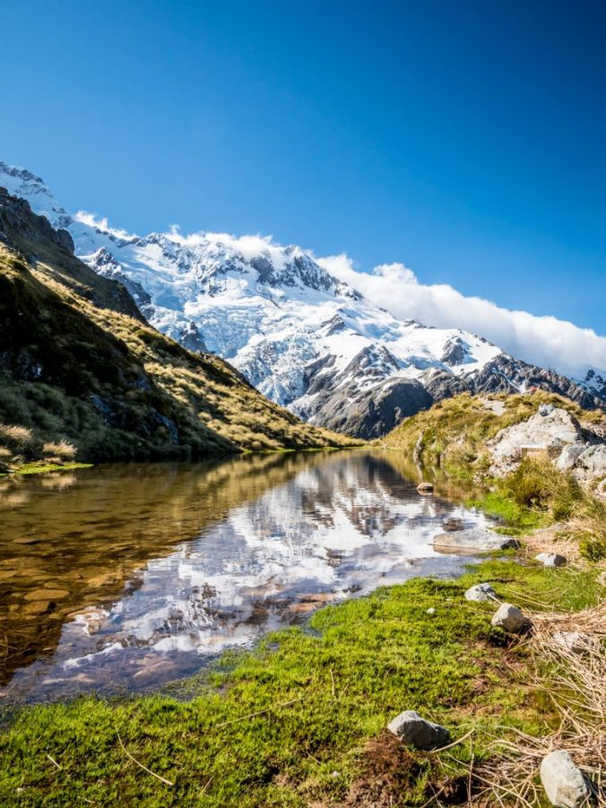 Aoraki Mount Cook reflects in the still waters of Sealy Tarns