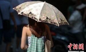 中国でもおしゃれな日傘が増えてきた。