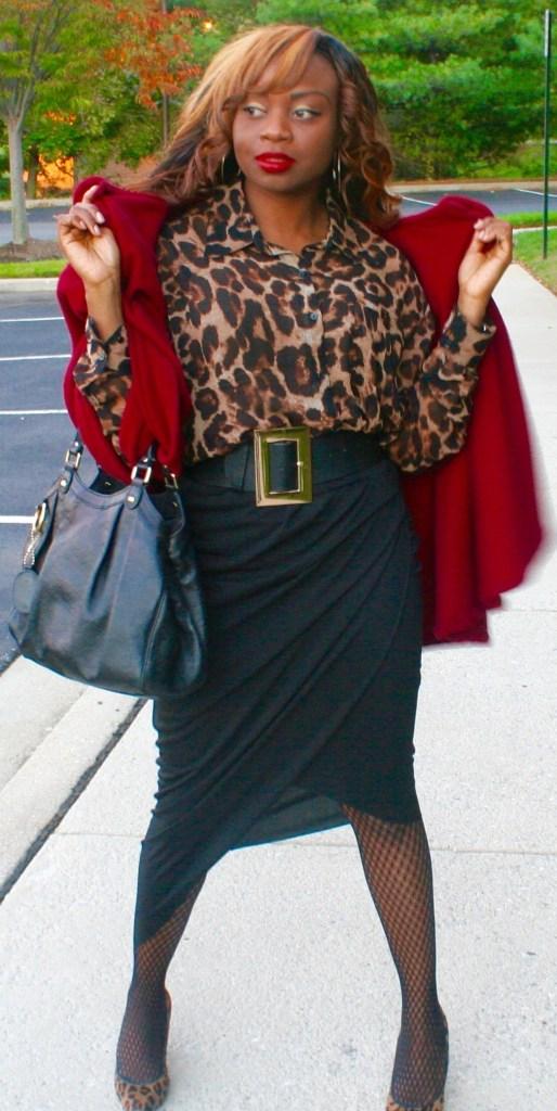 Animal print top, black asymmetrical wrap skirt, red cape, Gucci bag