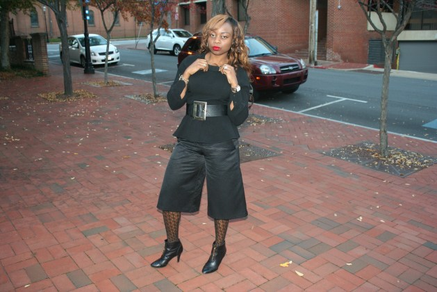 Black culottes with black peplum top, black patterned tights and black ankle boots2