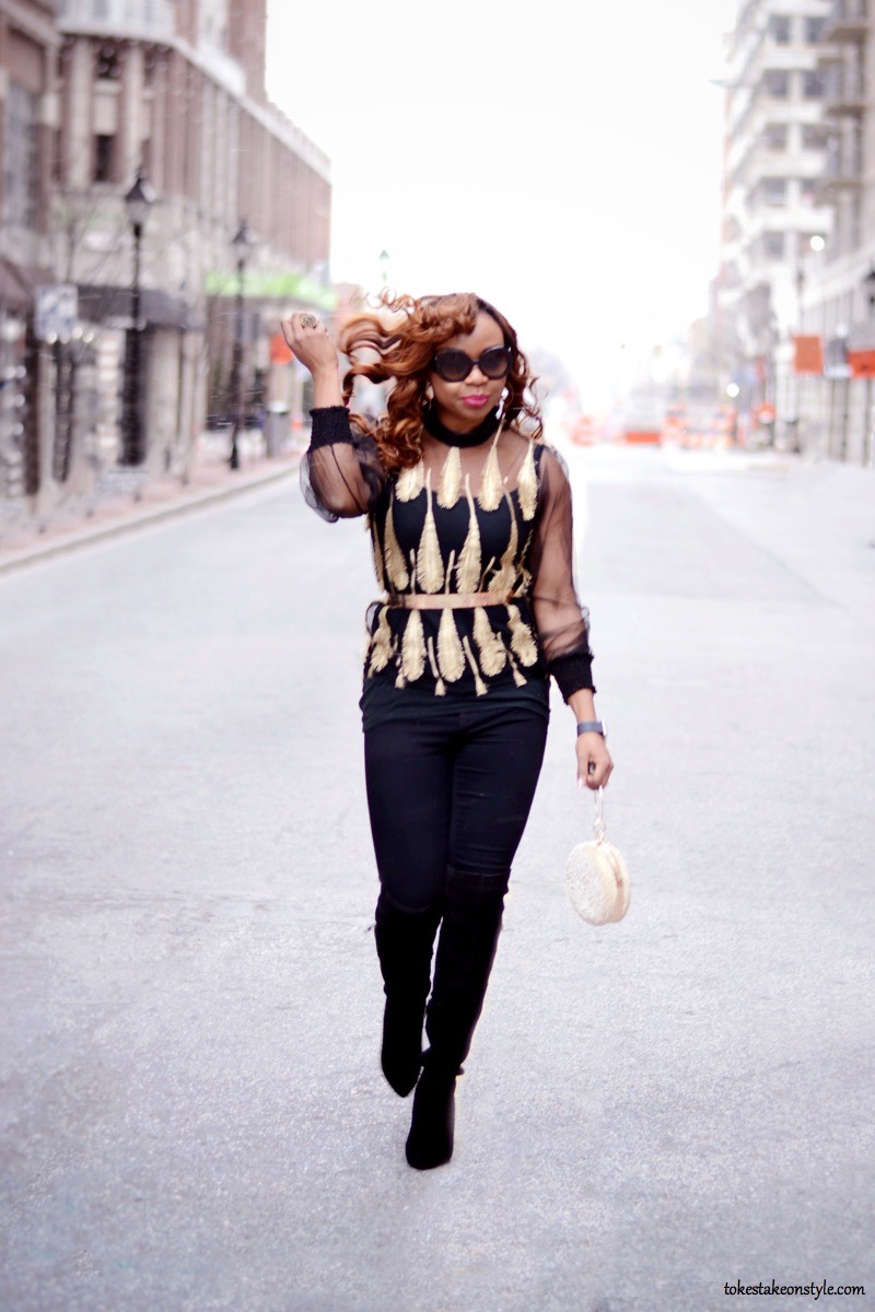 Street style blogger in black and gold top and black jeans