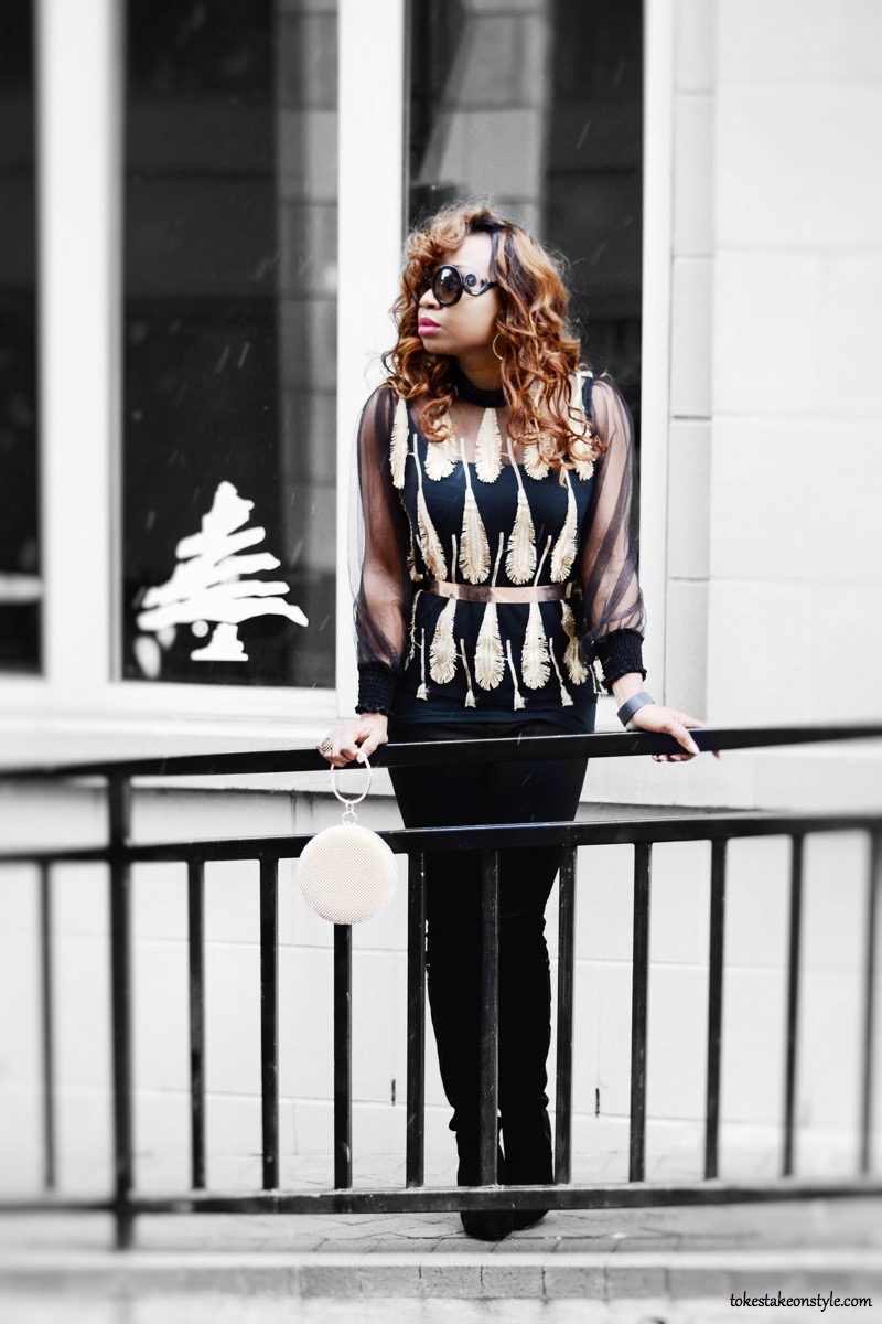 Valentine's Day outfit featuring black and gold top with black jeans