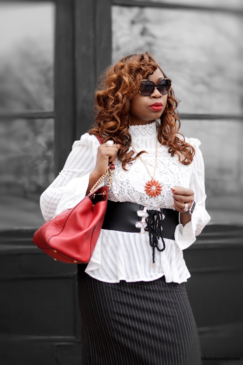 Corset belt and red Gucci bag