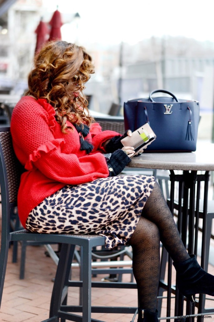 Animal print skirt and red sweater