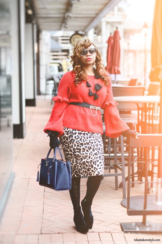 Red sweater with animal print skirt and Louis Vuitton Lockme too bag