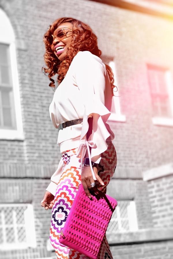 Fashion blogger smiling in Fashion Nova off shoulder top