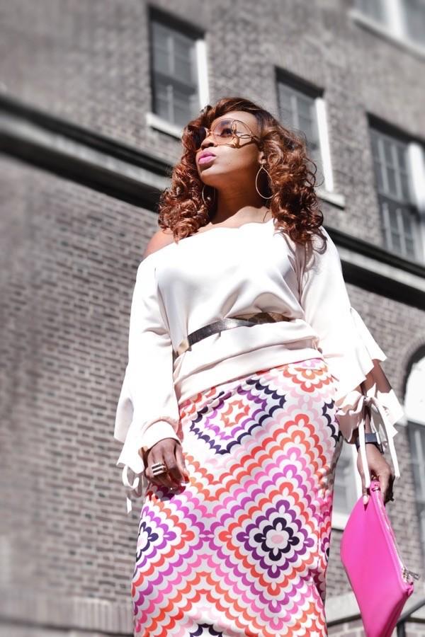 Fashion blogger in Fashion Nova off shoulder top