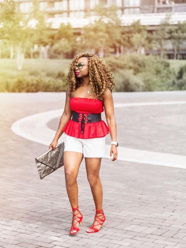Fashion blogger in black and white polka dot shorts