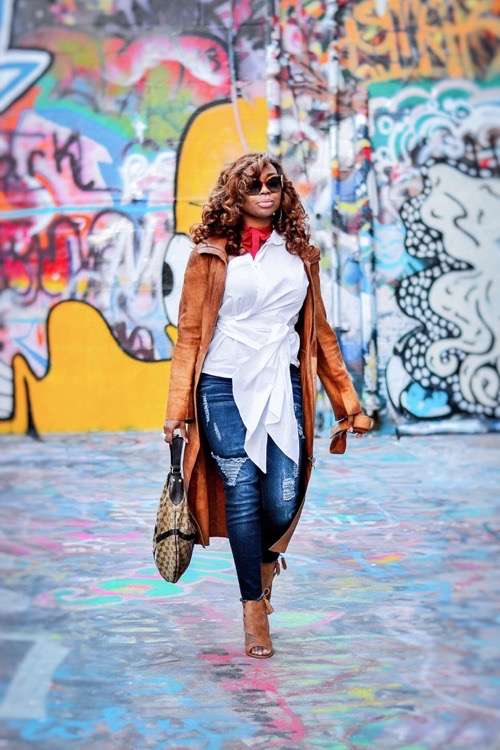 African-American fashion blogger in white asymmetrical top