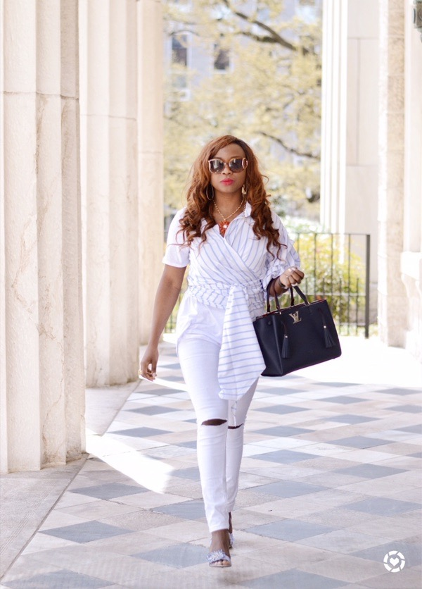 Black fashion blogger wearing white denim