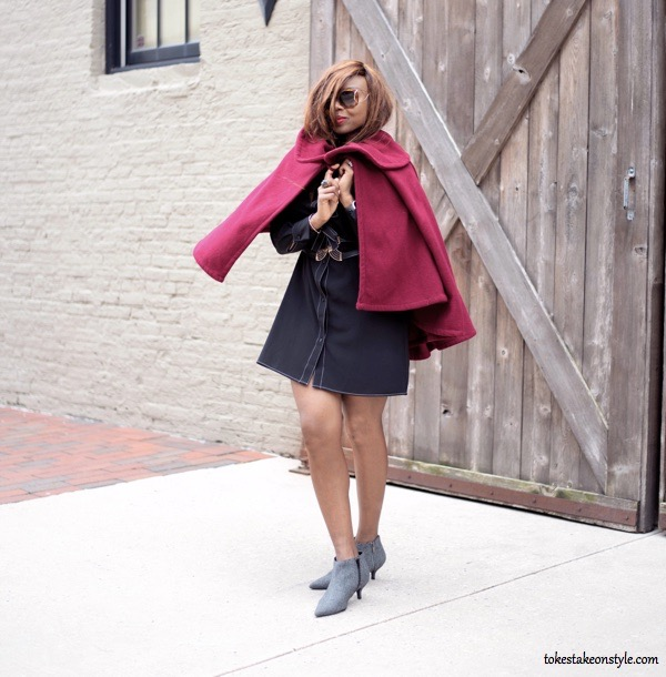 Black shirt dress and red cape