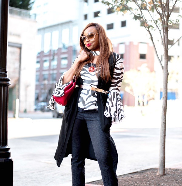 transition-your-summer-wardrobe-to-fall-woman-sleeveless-duster-zebra-print-top