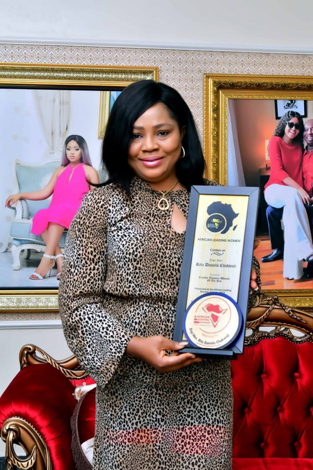 Hon. Rita Daniels Display her Award