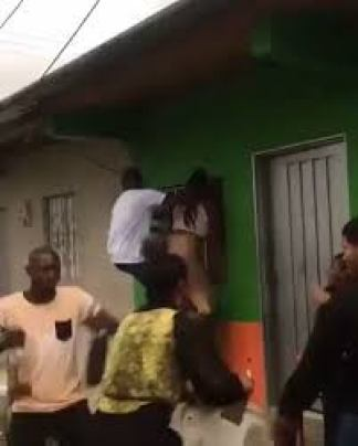VIDEO: Nigerian Man and His Girl Friend Falls and Break their Back While Dancing Hanging on A Building's Window