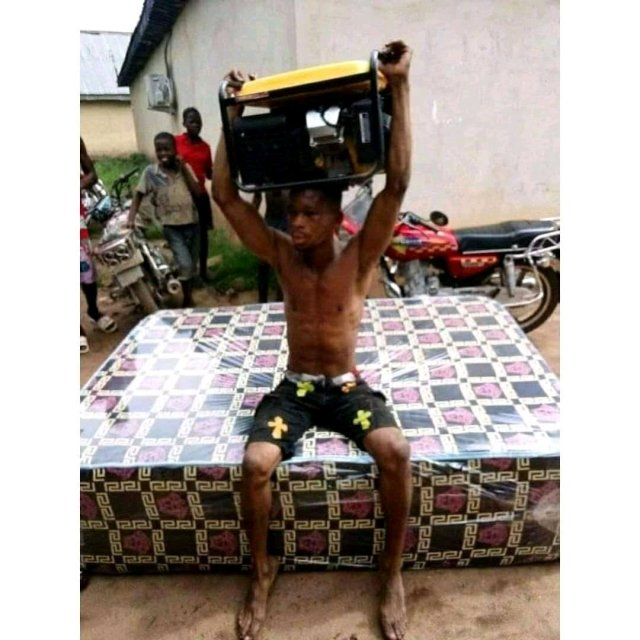 See The Thief Caught  and Made To Carry The Generator He Stole On His Head