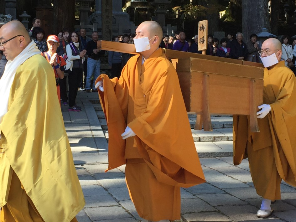 Monks preparing food for Kobo Daishi, who is fed directly by the head monk twice a day