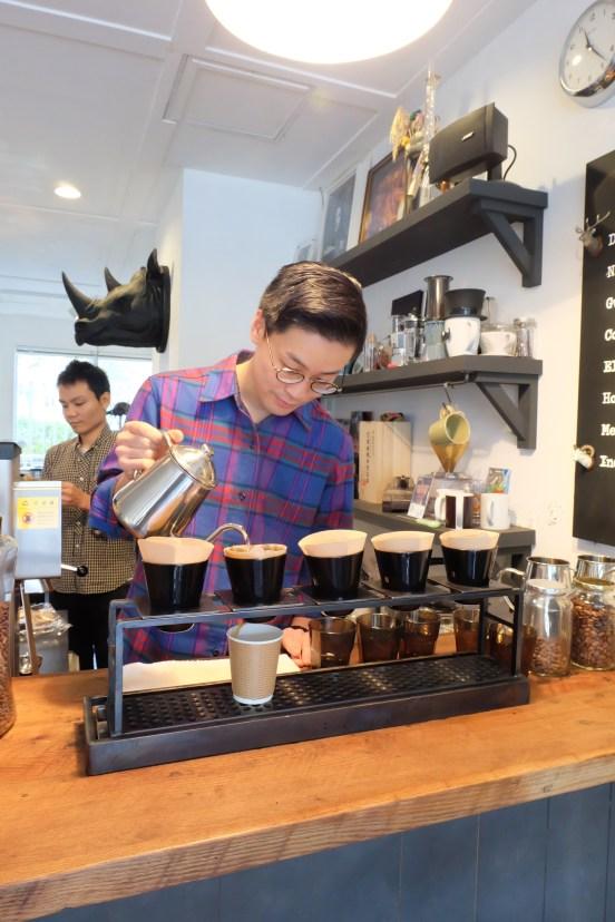 Barista making pour-over at Arise Coffee Entangle Kiyosumi Shirakawa Tokyo Japan