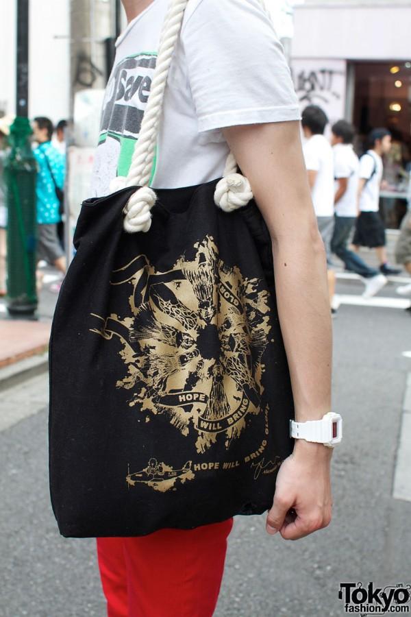 Alexander McQueen black & gold bag