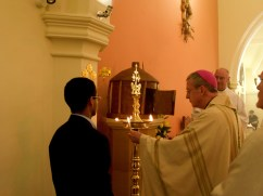 Bishop Declan lighting the Indian Lamp at the rededication of the Church, February 2008