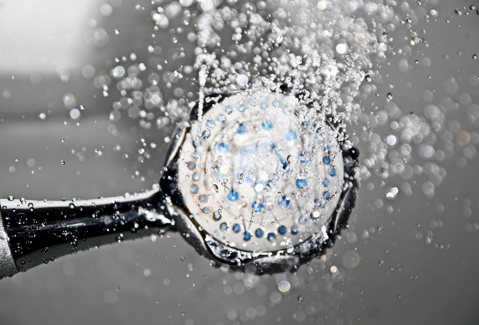save money on utility bills - black shower head switched on