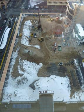 Note crane footing at middle-right, piling rebar at lower-right, poured piling (covered with black tarp) at upper-left.