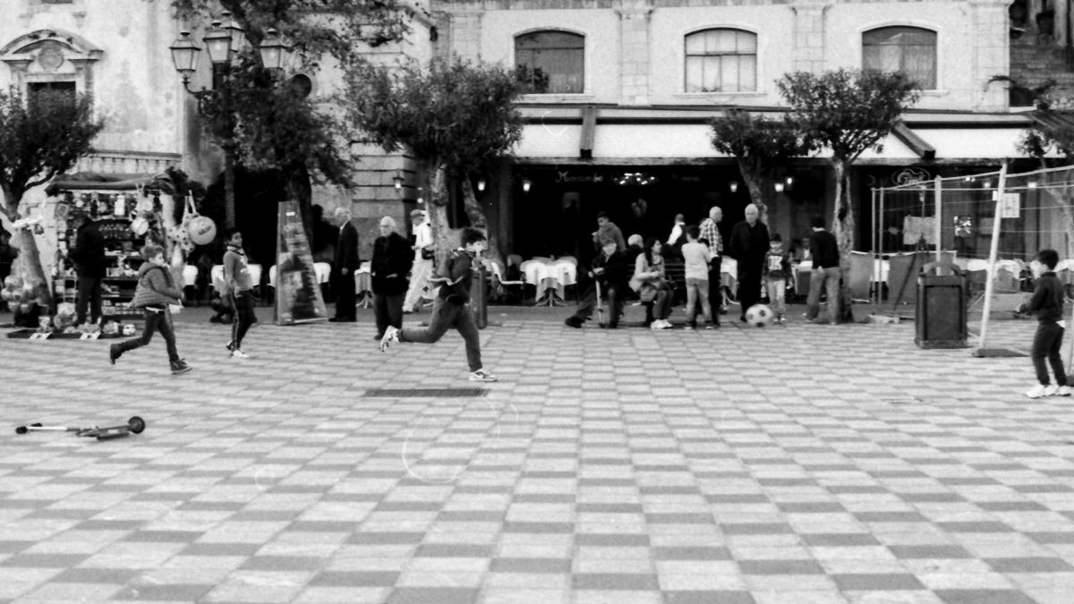 Children playing football. Taormina, Sicily