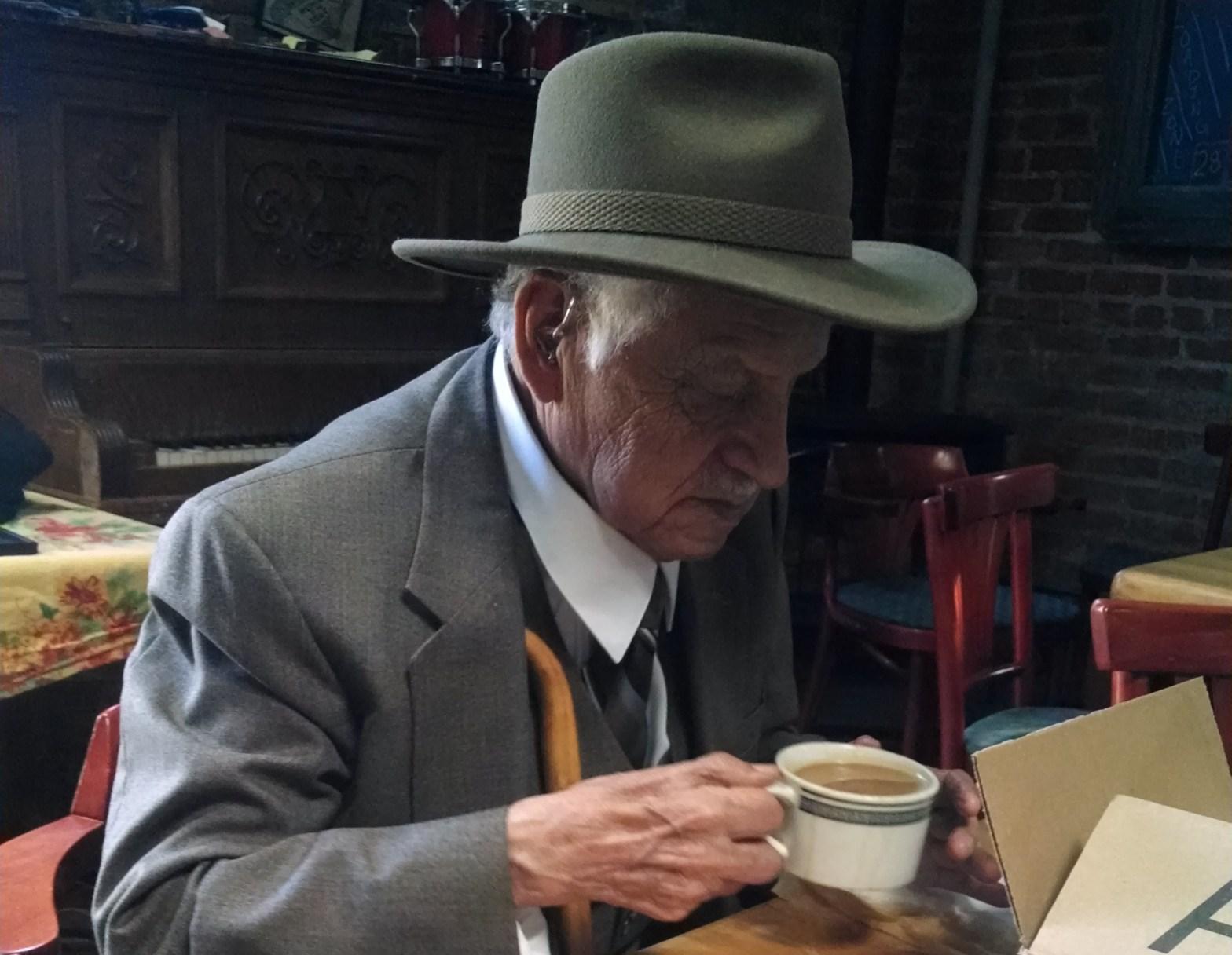 Don Tomas drinking coffee
