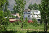 Osama Bin Laden's house.  The Pakistan Army's Dairy Farm is about 200 meters to the left, married soldiers housing for the Pakistan Military Academy in 400 meters away to the right, and a 24 hour army check point in 150 meters behind the photographer on the main road.