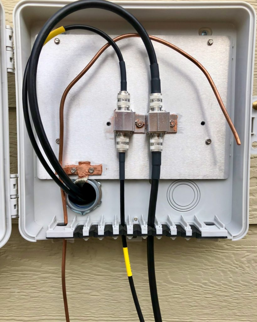 DXE Entry panel with a pair of PolyPhaser lightning arrestors