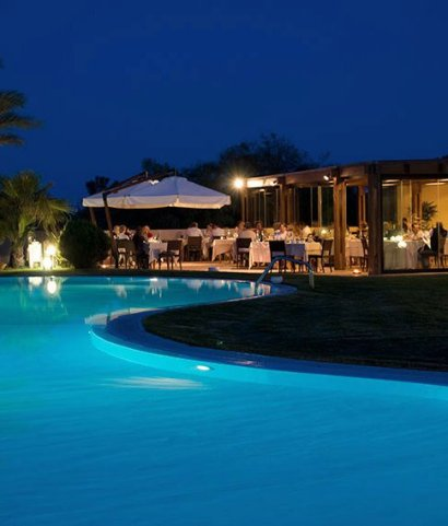 The pool and restaurant at night