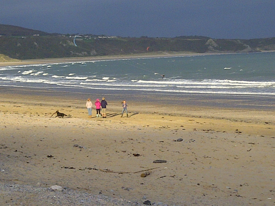 Waveriding at Oxwich Bay